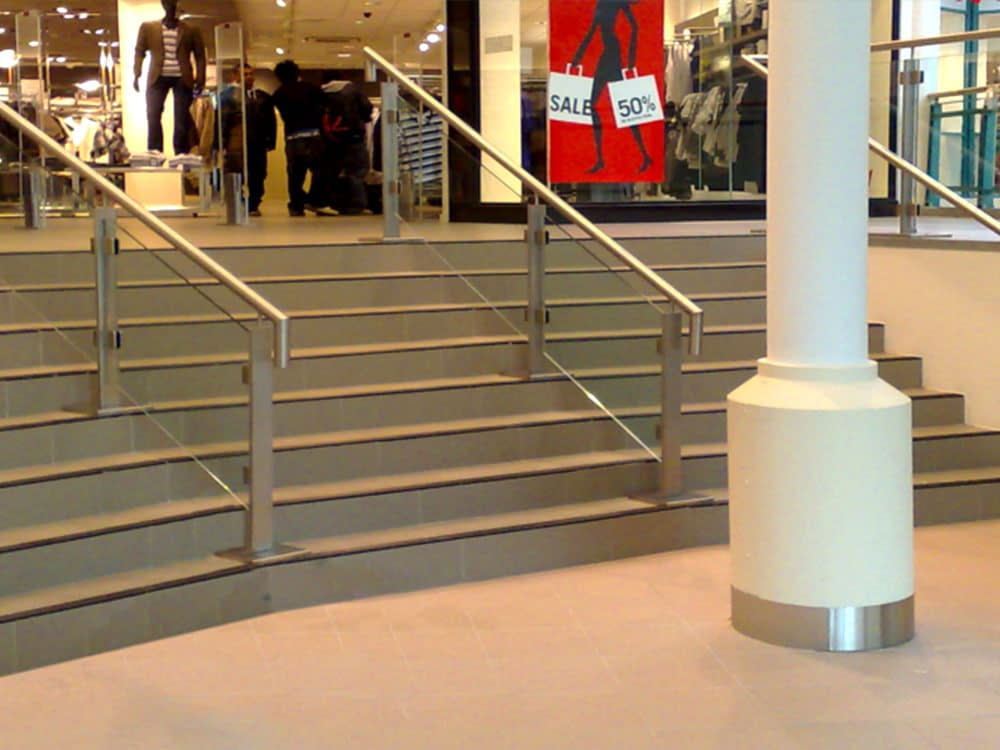 retail staircase with banister and glass